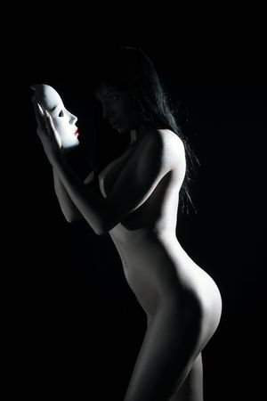 perfect females body in shadow with white mask photo