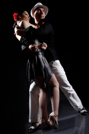 romantic tango dancing couple on black Stock Photo