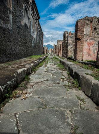 spqr: Ancient Pompeii Highway with Vesuvious Stock Photo