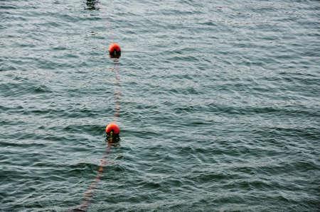 Orange buoy in the sea Stock Photo - 4923274