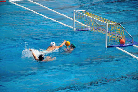 waterpolo: Water Polo game defense Stock Photo