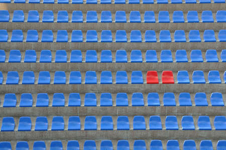 Blue and red seats outdoors in stadium