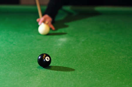 Putting billiard ball in a pocket