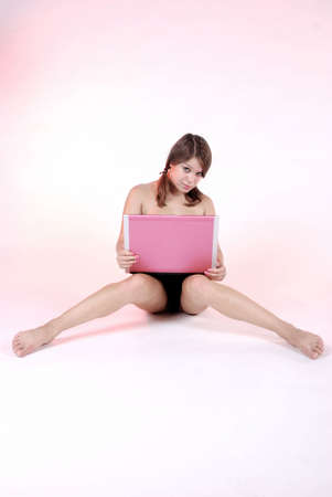 Sexy girl with pink laptop Stock Photo