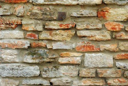 Unshaped stone wall pattern,wall made of rocks Stock Photo
