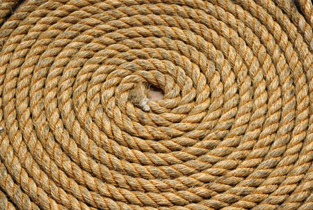 Heavy duty yellow coiled rope
