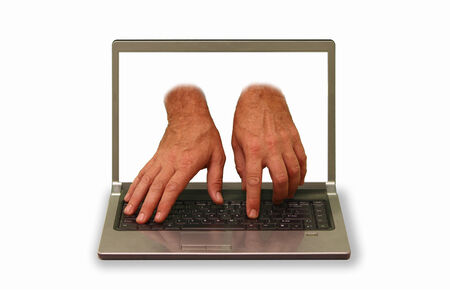 hands reaching out of laptop display and typing photo