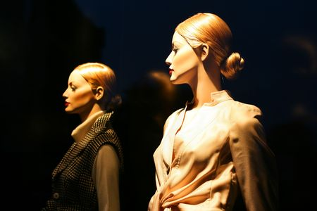 Mannequin in shop window of the fashionable shop photo