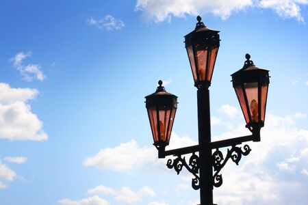 Old lanterns on background blue sky with cloud photo
