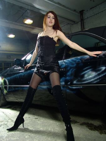 Beautiful sexy girl on background expensive black car photo