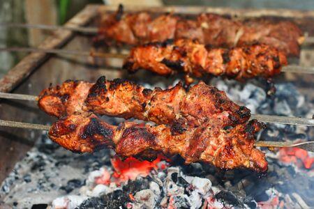 shish kebab: Appetizing shish kebab on metal skewers
