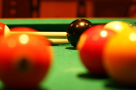Billiard balls on green broadcloth of the billiard table Stock Photo - 5316389