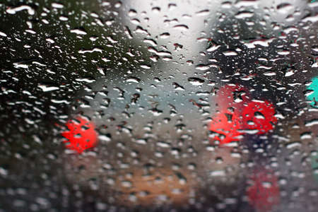 dripped: Dripped rain on front glass of the car