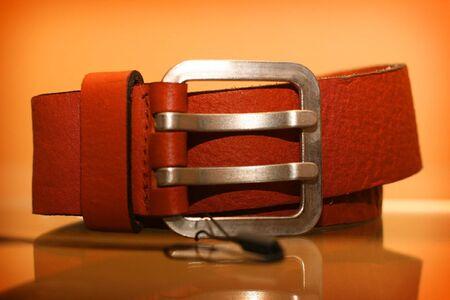 regiment: Leather belt rests upon regiment in shop