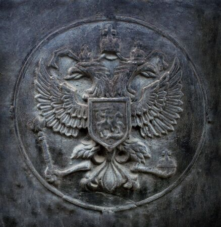 metal sculpture: Two-headed eagle, the state symbol of Russia. Cast iron relief