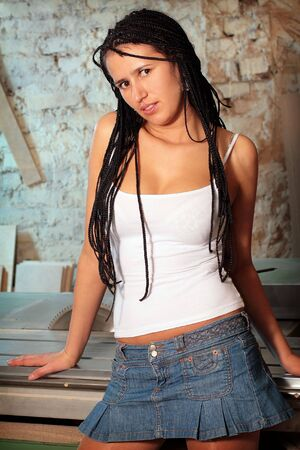 Seductive girl with african pigtails in white tanktop photo