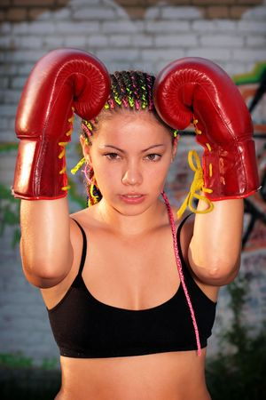 Portrait of a girl with red boxing gloves over graffiti background Stock Photo - 7579359