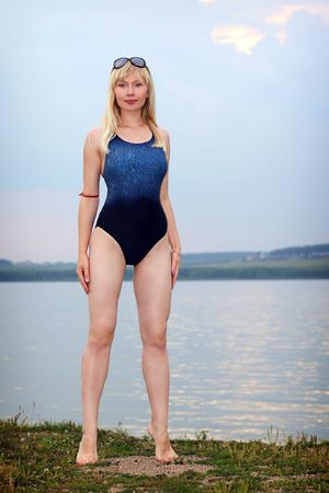 Lovely young girl in athletic swimsuit on beach Stock Photo - 8189871