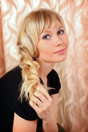 Beautiful sexy blond girl with plaited hairs photo