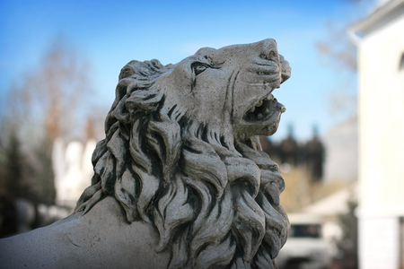 ambience: Stone statue of lion in town ambience