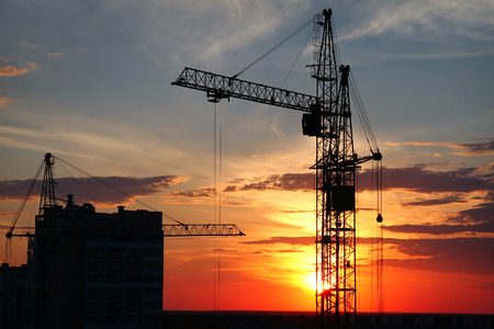 The tower crane on a background of the evening sky Stock Photo