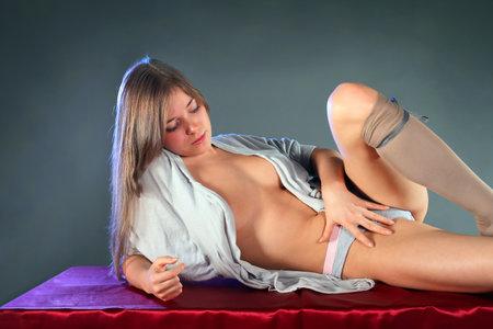 Beautiful blonde in lingerie posing in studio