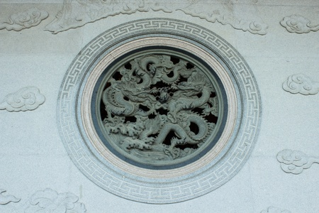 The dragon window of art on the temple photo