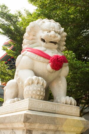 The marble lion infront the temple Chinese style of Thailand Stock Photo - 16125134