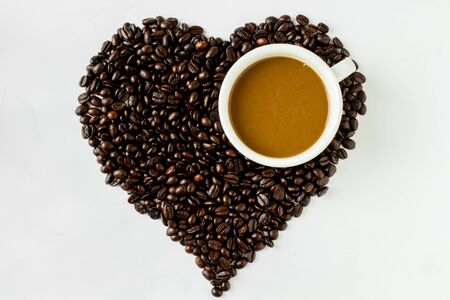 Coffee heart cup and coffee  beans Stock Photo - 17381902