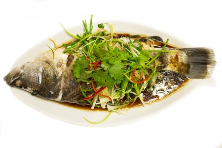 Snapper fish with soy sauce is steamed photo