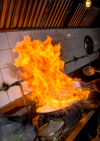 Fire gass burn is cooking on iron pan Stock fotó