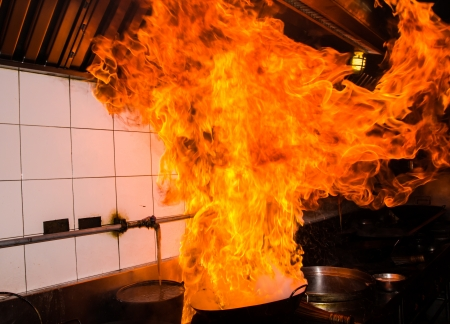gas stove: Fire gas burn is cooking on iron pan,stir fire very hot Stock Photo