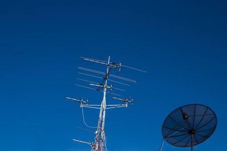 Satellite dish receiver on blue sky photo