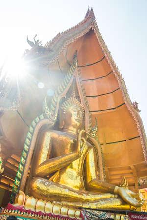 hunker: Flare sun light  beside Buddha