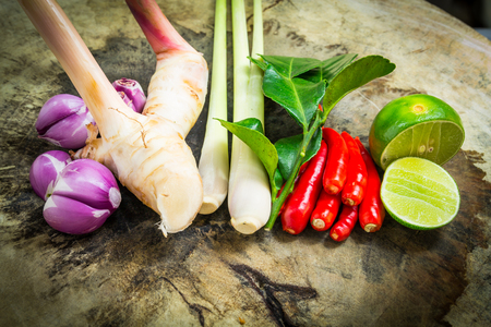 Thai herb ingredients for Tom Yum on wood photo