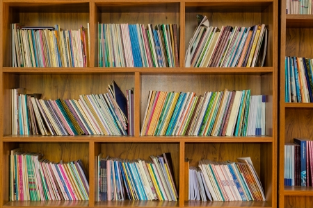 Books on a wooden shelfs. Stock fotó