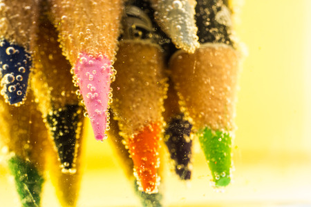 Pencil colors in soda water photo