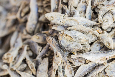 Dry fish on the open market in Asia photo