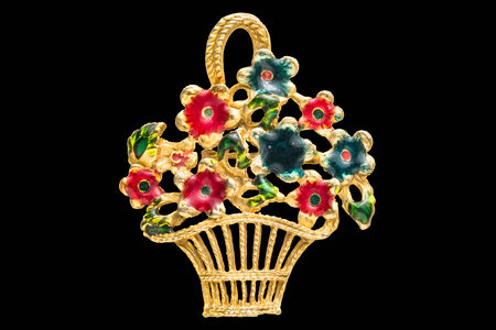 Retro brooch with flowers basket isolated photo