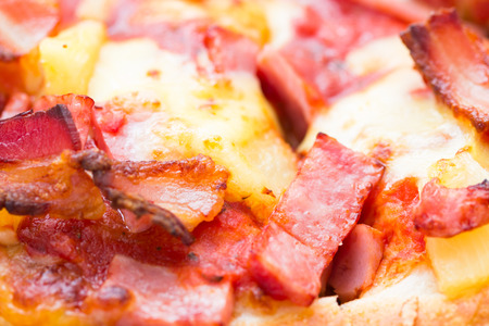 juicy Hawaiian pizza with pineapple and ham background macro. close up. top view photo