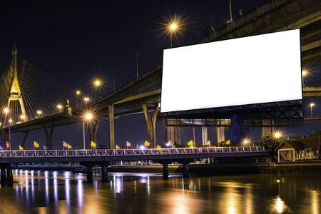 The big white billboard on night bridge.put your own text here photo