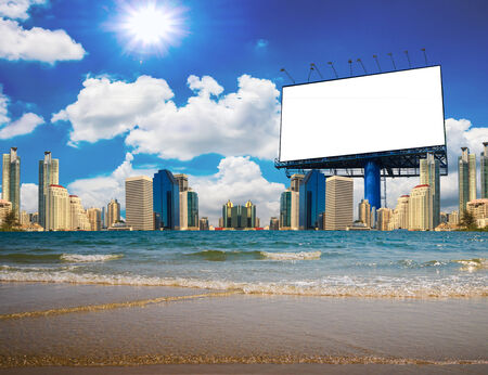 Blank billboard with sea at the city. Useful for your advertisement photo