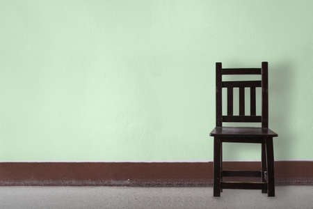 Wooden Chair vintage  in front wall photo