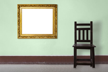 Wooden Chair vintage with frame  in front wall photo