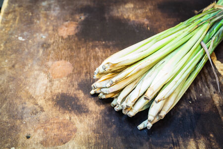 Lemon Grass on wood background photo