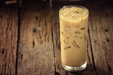 Iced coffee in glass on wooden Stock Photo