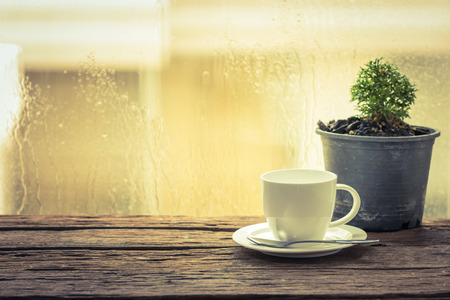 rain window: Coffee cup on a rainy day window background