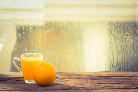 Orange juice and fruit in side the window