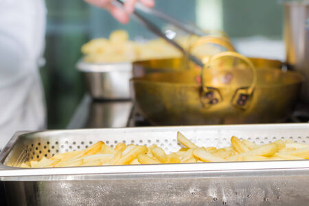 Chips production at a French fries stand. photo
