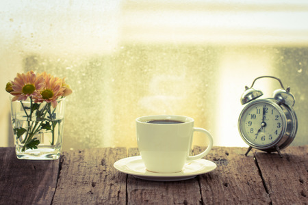 Coffee cup on a rainy day window background.coffee time. vintage